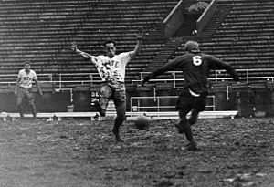 Pittsburgh Panthers men's soccer - Pitt playing East Stoudsburg in muddy conditions in Pitt Stadium during the first round of the 1965 NCAA soccer tournament