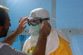 Ebola virus epidemic in Guinea - Médecins Sans Frontières staff dressed in protective clothing