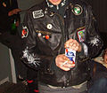 Puddle Cutters (Moped Army) party, black leather jacket with patches.jpg