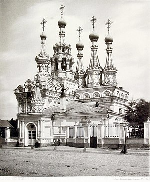 Nativity Church at Putinki - The snow-white church with its multiple tents and azure-and-gold domes resembles a daintily carved piece of ivory. Nativity Church in Putinki, Moscow, 1649-1653. Photo from the Album of Moscow Churches, published in 1882