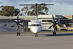 QantasLink (VH-QOU) Bombardier DHC-8-402Q taxiing at Wagga Wagga Airport (1).jpg