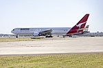 Qantas (VH-OGN) Boeing 767-338ER waiting at Echo holding point at Sydney Airport.jpg