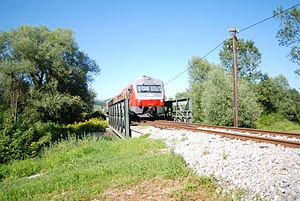 Sevnica–Trebnje Railway - Passenger train on the Sevnica–Trebnje Railway crossing the bridge over the Mirna at the settlement of Mirna