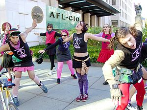 Radical cheerleading - The Resistin Radicatz, a radical cheerleading group, do a cheer in front of AFL-CIO headquarters in Washington before joining the Million Worker March at the Lincoln Memorial.