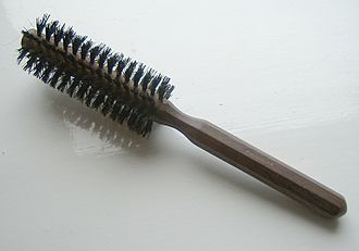 "Fiber bundle - A cylindrical hairbrush showing the intuition behind the term ""fiber bundle"". This hairbrush is like a fiber bundle in which the base space is a cylinder and the fibers (bristles) are line segments. The mapping π:E→B would take a point on any bristle and map it to its root on the cylinder."
