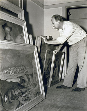 Russell Drysdale - Russell Drysdale with some canvases, taken by Australian photographer Max Dupain