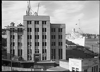 Sydney Cove West Archaeological Precinct - A 1949 image of part of the precinct, with the MSB building (now MCA) under construction and former wharf facilities in place; since removed and redeveloped.