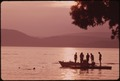SWIMMERS AND BOAT AT SUNSET ON FOURTH LAKE NEAR INLET, NEW YORK, IN THE ADIRONDACK FOREST PRESERVE - NARA - 554477.tif