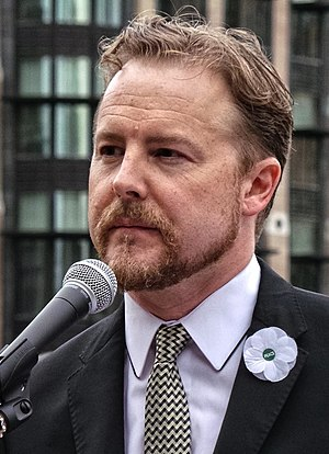 Samuel West - Samuel West wearing a Peace Pledge Union poppy at the No Glory protest, London, 4th August 2014