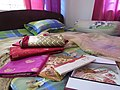 Saris, ornament, wedding cards in a bed 01.jpg