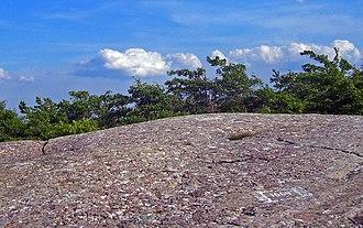 Schunemunk Mountain - Summit, with elevation chalked on nearby rock.