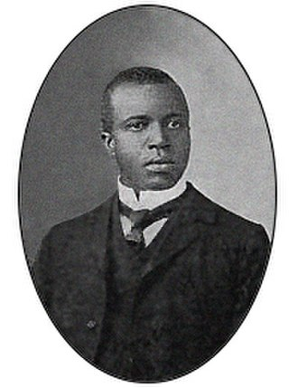 "Scott Joplin - Scott Joplin in June 1903. This picture also appears on the cover of ""The Cascades"" from 1904."