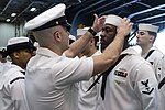 Senior Chief inspects Sailors' dress white uniforms in the hangar bay of USS Dwight D. Eisenhower. (25956780463).jpg