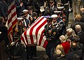 Service members from the ceremonial honor guard transport the casket of George H. W. Bush. (46166890622).jpg