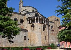 The apse of the Cathedral of la Seu d'Urgell, Spain, has a round-topped windows, an arcade with colonnettes and an occular window.pic K.Jeaves