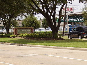 Sharpstown, Houston - A sign in a median indicating Sharpstown