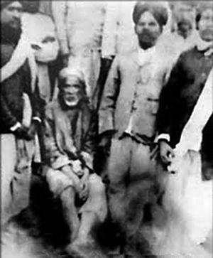 English: Sai Baba of Shirdi sitting among his ...