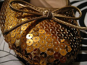 Sequin - Gold sequins on a shoe