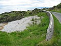 Shoreline wall and beach on the B8001 near Skipness. - geograph.org.uk - 181055.jpg