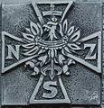 Sign (cross) of Narodowe Siły Zbrojne (NSZ) at plaque in Sanok.jpg