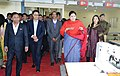 Smriti Irani accompanied by the Chief Minister of Meghalaya, Dr. Mukul Sangma and the Minister of State for Home Affairs, Shri Kiren Rijiju inspects the Apparel & Garment Making Centre, at Hatisil, Ampati, in Meghalaya.jpg