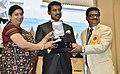 Smriti Irani presenting the Rajat Kamal Award to Satyender Prakash (Best Adventure Film) for the Non-Feature film – LADAKH CHALE RICKSHAWALA, at the 65th National Film Awards Function, in New Delhi.JPG