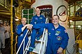 Soyuz MS-08 crew members in front of their encapsulated spacecraft.jpg