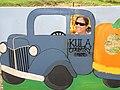Starr-111004-0584-Cucurbita pepo-Kim driving pumpkin patch truck-Kula Country Farms-Maui (24822758470).jpg
