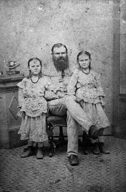 StateLibQld 1 52768 William Landsborough pictured with two of his daughters, ca. 1870.jpg