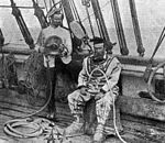 StateLibQld 2 112316 Captain Porter and J. C. Outridge on the deck of the ship, Crest of the Wave.jpg