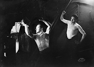 Fireman (steam engine) - Stokers in the boiler room on board HMT Stella Pegasi, Scapa Flow, 6 June 1943