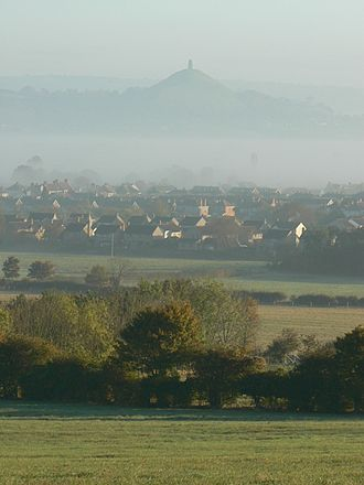 Glastonbury Tor - Street and Glastonbury Tor viewed, above the mist, from Walton Hill