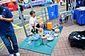 Street performer playing with household items in a Hong Kong street.jpg