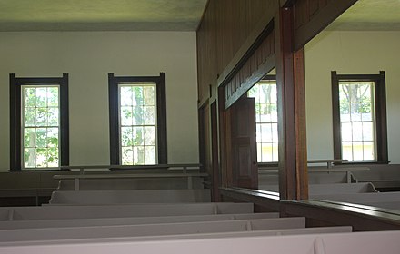 Sugar Grove Conservative Friends Meeting House, built 1870 in Indiana, with an openable partition between male and female sections SugarGroveFriendsDivision.jpg