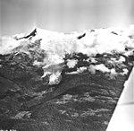 Sumdum Glacier, mountain glacier partially obscured by clouds, August 28, 1969 (GLACIERS 5901).jpg