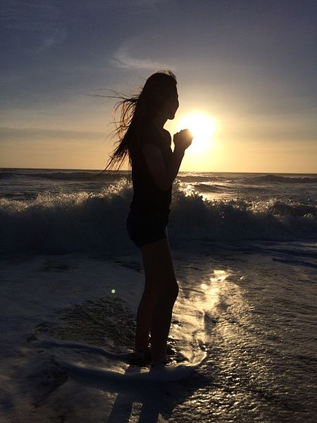 File:Sunset and Girl on a Beach.jpg