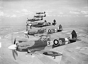 Supermarine Spitfire (Griffon-powered variants) - Spitfire F Mk XIIs of 41 Sqn. MB882, flown by Flt. Lt. Donald Smith, RAAF, was the final production Spitfire XII. EB-H in the background shows the fixed tailwheel of an ex-Spitfire VC airframe.