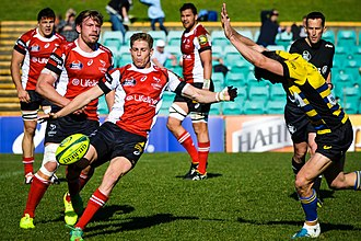 Rugby union in the Australian Capital Territory - 2014 NRC: Michael Dowsett, playing for the UC Vikings, kicks ahead against Sydney.