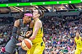 Sylvia Fowles (34) handles the ball as she's guarded by Breanna Stewart (30) in the Minnesota Lynx vs Seattle Storm game at Target Center.jpg