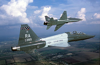 Northrop T-38 Talon - Air-to-air right side view of a USAF T-38 Talon aircraft from 560th Flying Training Squadron, Randolph AFB, TX as his lead performs a left pitchout