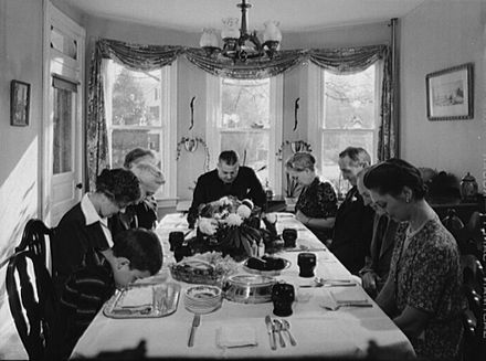 Christian family saying grace before eating. Thanksgiving grace 1942.jpg