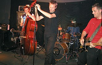 The Ex (band) - The Ex in concert on 16 June 2004 in Germany. Left to right: Rozemarie Heggen, G.W. Sok, Katherina Bornefeld, Andy Moor