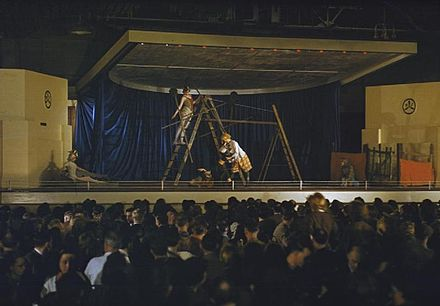 Dancers from the Ballet Rambert, under the auspices of CEMA perform Peter and The Wolf at an aircraft factory in the Midlands during World War II The Ballet Rambert Visiting An Aircraft Factory in Britain TR969.jpg