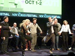 Actors from Arrested Development dancing on a stage