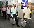 The Electoral Official carrying Electronic Voting Machines (EVMs) for counting, at a Counting Centre of General Election-2014, in New Delhi on May 16, 2014.jpg