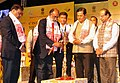 The Minister of State for Tourism (IC) and Electronics & Information Technology, Shri Alphons Kannanthanam lighting the lamp at the inauguration of the 6th International Tourism Mart 2017, in Guwahati.jpg