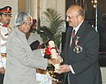 The President, Dr. A.P.J. Abdul Kalam presenting the Padma Bhushan Award – 2006 to well-known Industrialist and aviator Dr. Vijaypat Singhania, in New Delhi on March 20, 2006.jpg