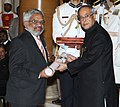 The President, Shri Pranab Mukherjee presenting the Padma Shri Award to Shri M. Chandradathan, at an Investiture Ceremony-II, at Rashtrapati Bhavan, in New Delhi on April 26, 2014.jpg