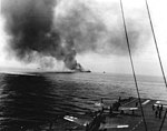 The burning USS Bunker Hill (CV-17) seen from USS Randolph (CV-15) on 11 May 1945 (NNAM.1996.253.7178.020).jpg