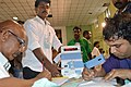 The counting of votes in progress, at a Counting Centre of General Election-2014, at the Chennai – North constituency, in Queen Mary's College, Chennai on May 16, 2014.jpg